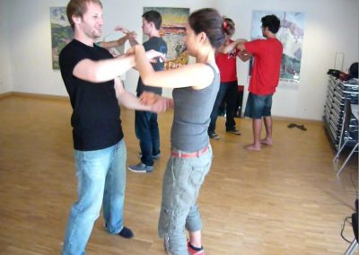 2nd-workshop-6-people-doing-chi-sau-cut-from-video-2-Smiling
